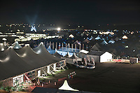 All the tents are visible from the Central Tower at night as the scouts have lighting in different colours lighting their temporary homes. To the left you can see the Jamboree shop and behind that you see the lit tents of the food houses. Furthest away is the Welcoming Portal. To the right you can see parts of the Autumn sub camp. Photo: Eric Hampusgård/Scouterna