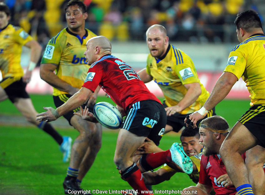 Willi Heinz loses the ball in Ardie Savea's tackle during the Super Rugby match between the Hurricanes and Crusaders at Westpac Stadium, Wellington, New Zealand on Saturday, 28 June 2014. Photo: Dave Lintott / lintottphoto.co.nz