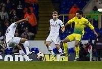 12.12.2013 London, England. Tottenham Hotspur defender Kyle Naughton (16) tackles Anzhi Makhachkala forward Serder Serderov (28) during the Europa League game between Tottenham Hotspur and Anzhi Makhachkala from White Hart Lane.