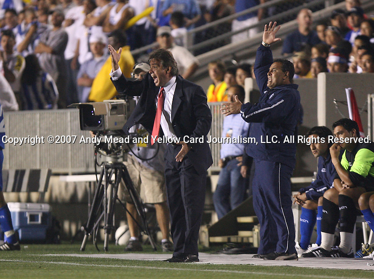 El Salvador head coach Carlos de los Cobos (l) yells at the referee on Tuesday, March 27th, 2007 at SAS Stadium in Cary, North Carolina. The Honduras Men's National Team defeated El Salvador 2-0 in a men's international friendly.