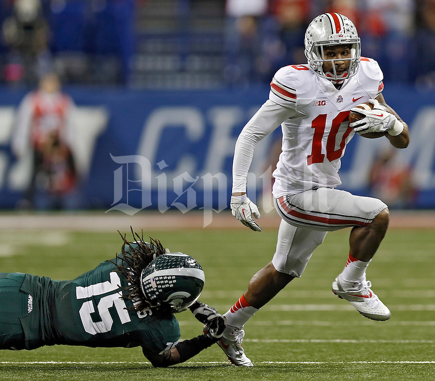 Ohio State Buckeyes wide receiver Philly Brown (10) gets past Michigan State Spartans cornerback Trae Waynes (15) after a catch in the 2nd quarter during the Big 10 Championship game at Lucas Oil Stadium in Indianapolis, Ind on December 7, 2013.  (Dispatch photo by Kyle Robertson)