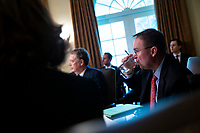 Mick Mulvaney, acting White House chief of staff, takes a drink of water as U.S. President Donald Trump speaks during a cabinet meeting in the Cabinet Room of the White House, on Wednesday, Jan. 2, 2019 in Washington, D.C. Photo Credit: Al Drago/CNP/AdMedia