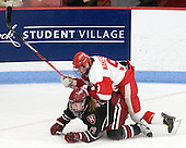 Kaitlin Spurling (Harvard - 17), Jenn Wakefield (BU - 9) - The Boston University Terriers defeated the Harvard University Crimson 5-2 on Monday, January 31, 2012, in the opening round of the 2012 Women's Beanpot at Walter Brown Arena in Boston, Massachusetts.