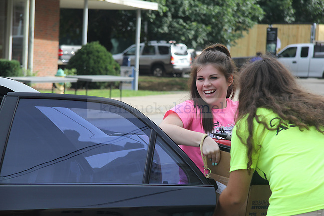 Freshman Haley Coleman, eagerly pulls boxes out of her car as she moves into the dorms for the 2014- 2015 school year Lexington, Ky., on Thursday August 21, 2014. Photo by Joel Repoley | Staff