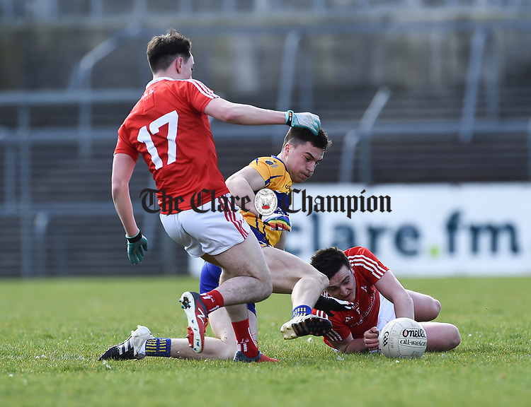 Jamie Malone of Clare in action against Fergal Donohue and Tommy Durnin of Louth during their national League game in Cusack Park. Photograph by John Kelly.