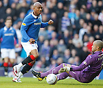 El Hadji Diouf tried to dink the ball past Motherwell keeper Darren Randolph