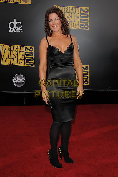 SARA McLACHLAN.The 2008 American Music Awards held at Nokia Theatre L.A. Live in Los Angeles, California, USA. .November 23rd, 2008 .ama amas ama's arrivals full length black silk satin dress tights sarah maclachlan .CAP/DVS.©Debbie VanStory/Capital Pictures.