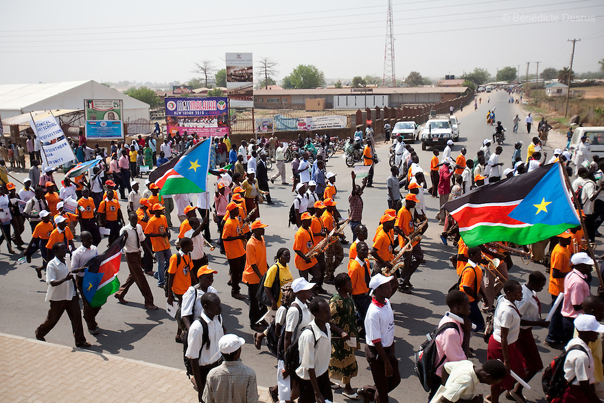 9 december 2010 - Juba, South Sudan - Southern Sudanese citizens chant slogans and hold placards as they march in the streets in support of the independence referendum in Juba, South Sudan. According to South Sudanese officials, more than 2.8 million people have registered to vote in the referendum. The referendum on whether the oil-producing region should declare independence, scheduled for Jan. 9, is the climax of a 2005 peace deal that ended decades of north-south conflict - Africa's longest civil war that was fought over ethnicity, religion, ideology and oil and that killed 2 million people. Photo credit: Benedicte Desrus