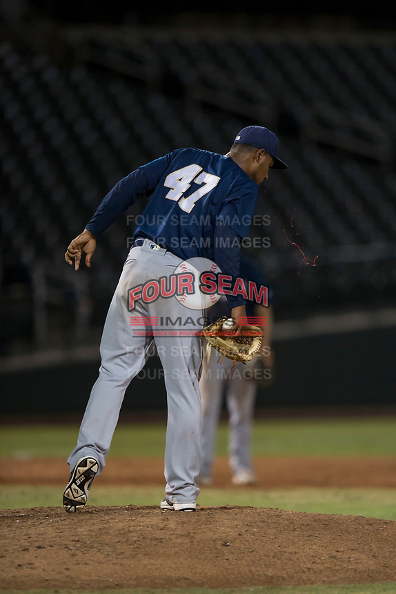 AZL Brewers relief pitcher Johan Dominguez (47) suffers a bloody nose during an Arizona League game against the AZL Cubs 1 at Sloan Park on June 29, 2018 in Mesa, Arizona. The AZL Cubs 1 defeated the AZL Brewers 7-1. (Zachary Lucy/Four Seam Images)