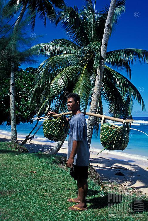 Man with baskets. Failolo, Tutuila, American Samoa