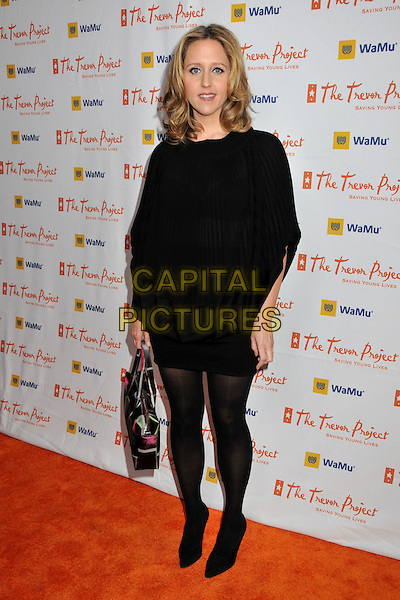 "BROOKE SMITH .11th Annual Trevor Project's ""Cracked XMas"" Benefit at the Wiltern Theatre, Los Angeles, CA, USA, 7th December 2008..full length black dress tights bag .CAP/ADM/BP.©Byron Purvis/Admedia/Capital PIcture"