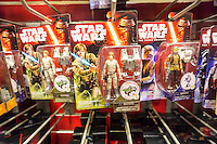 "Star Wars merchandise in the Toys R Us store in Times Square in New York on so-called ""Force Friday"", September 4, 2015. ""Force Friday"" is the name given by the Walt Disney Co. on the release of the Star Wars merchandise, three months prior to the release of the film. Disney acquired the Star Wars franchise in 2012 when it bought Lucasfilm for $4.1 billion. (© Richard B. Levine)"