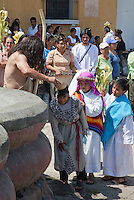 John the Baptist Baptizes Children.  Palm Sunday Re-enactment of events in the life of Jesus, by the group called Luna LLena (Full Moon), a group of volunteers in Antigua, Guatemala.
