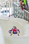 5 December 2014: Adam Rosen, sliding for Great Britain, crosses the finish line on his first run, ending the day with a 24th place finish and a combined 2-run time of 1:45.025 in the Men's Competition at the Viessmann Luge World Cup, at the Olympic Sports Track in Lake Placid, New York, USA. Mandatory Credit: Ed Wolfstein Photo *** RAW (NEF) Image File Available ***
