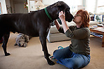 Kathy Bowler kisses her dog Liam at her home in Sacramento, California, March 17, 2013.
