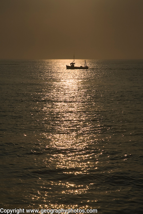 Fishing boat in the North Sea at the mouth of the River Ore, Shingle Street, Suffolk, England