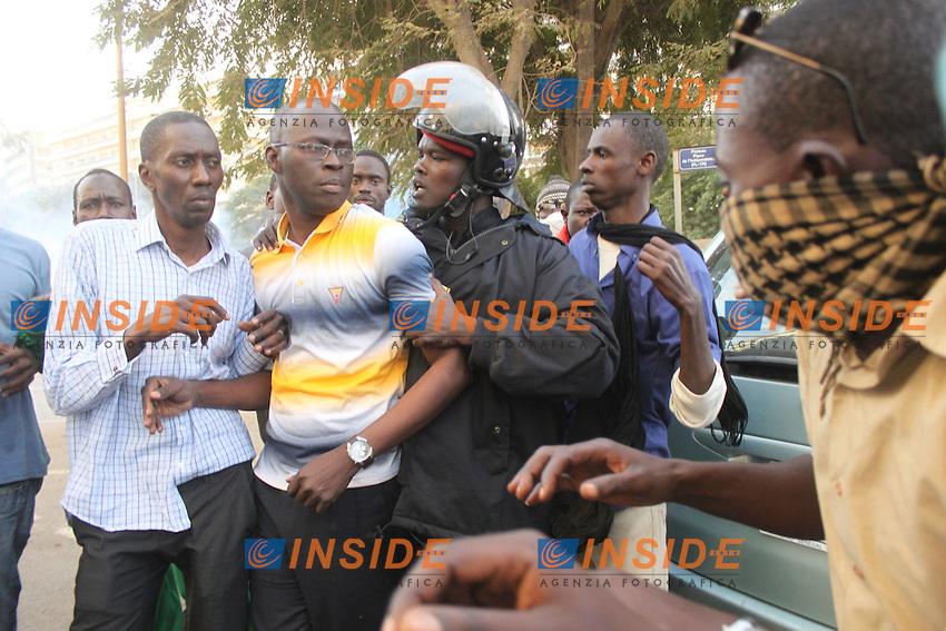 BAMBA DIEYE fermato dalla polizia.Dakar ( Senegal ) 18/2/2012.Manifestazioni Antigovernative .Foto Insidefoto / Philippe Lemire / Panoramic.ITALY ONLY