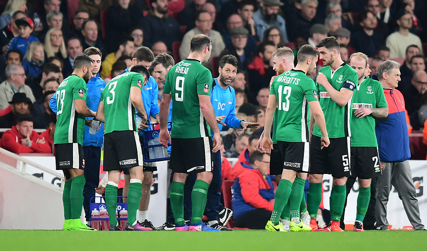 Lincoln City manager Danny Cowley, centre, speaks to his players during a break in play<br /> <br /> Photographer Chris Vaughan/CameraSport<br /> <br /> The Emirates FA Cup Quarter-Final - Arsenal v Lincoln City - Saturday 11th March 2017 - The Emirates - London<br />  <br /> World Copyright &copy; 2017 CameraSport. All rights reserved. 43 Linden Ave. Countesthorpe. Leicester. England. LE8 5PG - Tel: +44 (0) 116 277 4147 - admin@camerasport.com - www.camerasport.com