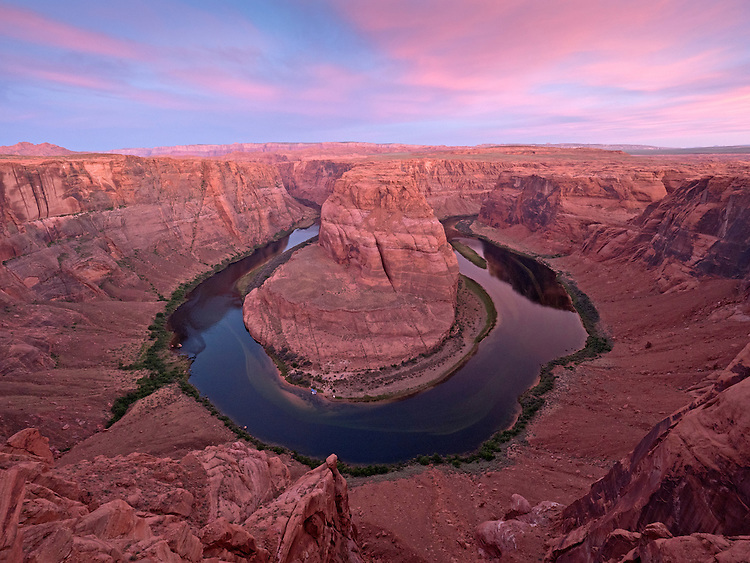 Colorful sunrise over the Colorado River at Horseshoe Bend in the Glen Canyon National Recreation Area near Page, Arizona, USA