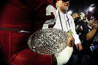 Jan 7, 2010; Pasadena, CA, USA; Alabama Crimson Tide linebacker Rolando McClain (25) holds the Coaches' Trophy after defeating the Texas Longhorns 37-21 in the 2010 BCS national championship game at the Rose Bowl. Mandatory Credit: Mark J. Rebilas-..