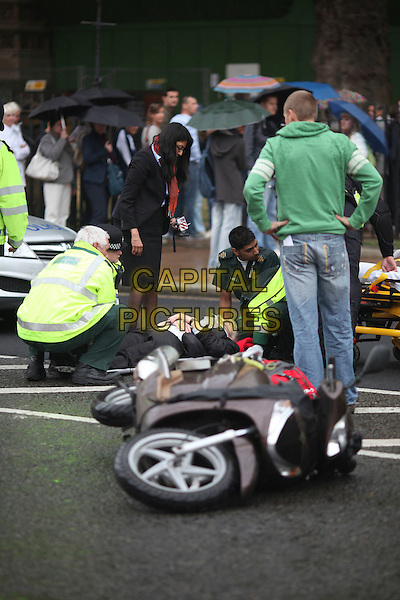 LORD FREUD.involved in a road traffic accident involving a scooter, outside the Houses of Parliament, London, England 5th May 2011.The casualty, named by staff (pictured), was taken away by ambulance. A catering bag of carrots was recovered from the scene by police.  It's unclear as to whether Lord Freud was riding the scooter registration LB08FKR..**EXCLUSIVE ALL-ROUNDER**.atmosphere gv general view police policemen collision hurt ill.CAP/CAM.©Andre Camara/Capital Pictures.