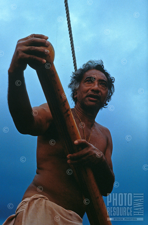 Man at the helm of a Hokelea in Honaunau, Hawaii