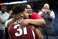 NWA Democrat-Gazette/CHARLIE KAIJO Katina Brown of North Little Rock hugs her son Arkansas Razorbacks guard Anton Beard (31) after the Arkansas Razorbacks won in the Southeastern Conference Men's Basketball Tournament quarterfinals, Friday, March 9, 2018 at Scottrade Center in St. Louis, Mo. Arkansas Razorbacks defeated Florida Gators 80-72