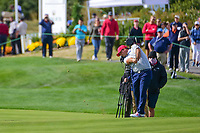 Patrick Reed (USA) hits his approach shot on 14 during round 3 Foursomes of the 2017 President's Cup, Liberty National Golf Club, Jersey City, New Jersey, USA. 9/30/2017.<br /> Picture: Golffile | Ken Murray<br /> <br /> All photo usage must carry mandatory copyright credit (&copy; Golffile | Ken Murray)