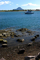 White Island, New Zealand's only active marine volcano, is seen on the horizon from the shoreline at Whakatane, North Island, New Zealand. 201003154116..Copyright Image from Victor Patterson, 54 Dorchester Park, Belfast, UK, BT9 6RJ..Tel: +44 28 9066 1296.Mob: +44 7802 353836.Voicemail +44 20 8816 7153.Skype: victorpattersonbelfast.Email: victorpatterson@mac.com.Email: victorpatterson@ireland.com (back-up)..IMPORTANT: If you wish to use this image or any other of my images please go to www.victorpatterson.com and click on the Terms & Conditions. Then contact me by email or phone with the reference number(s) of the image(s) concerned.