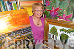 ART ATTACK: Carol Noonan from Ballyhahill with some the art work she is displaying at Glin Library.