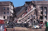 View of the west-facing wall of the Pentagon in Washington, DC on the late afternoon of September 12, 2001.  Approximately 30 hours earlier,  American Airlines Flight 77, a Boeing 757 with 64 passengers aboard was purposely crashed into this spot in an act of terrorism.  <br /> Credit: DoD via CNP