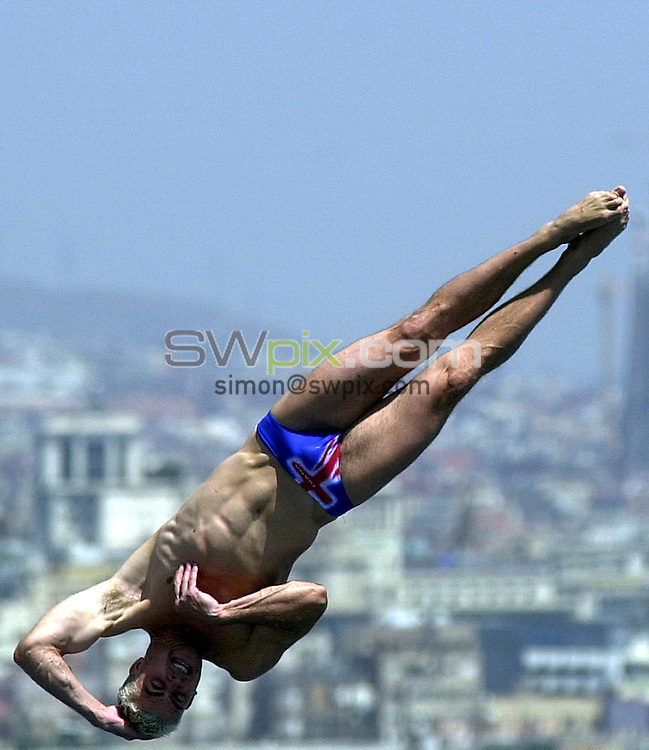 Pix: Matthew Lewis/SWpix.com. Diving. 10th Fina World Championships 2003, Barcelona. 19/07/2003...COPYRIGHT PICTURE>>SIMON WILKINSON>>01943 436649>>..Great Britain's Leon Taylor competes in the Mens 10m Platform Preliminary's.