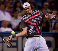 John Isner lines up a forehand during the Legg Mason Tennis Classic at the William H.G. FitzGerald Tennis Center in Washington, DC.  Unseeded Xavier Malisse defeated American John Isner in three sets in a thunderstorm delayed evening session.