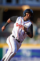 Lansing Lugnuts shortstop Richard Urena (1) rounds third during a game against the Peoria Chiefs on June 6, 2015 at Cooley Law School Stadium in Lansing, Michigan.  Lansing defeated Peoria 6-2.  (Mike Janes/Four Seam Images)