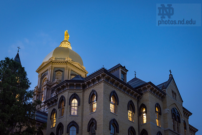 July 20, 2017; Main Building at dusk (Photo by Matt Cashore/University of Notre Dame)