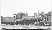 3/4 engineer's-side view of D&amp;RGW locomotive #302 in storage at Alamosa with parts missing.<br /> D&amp;RGW    Taken by Perry, Otto C. - 7/5/1937