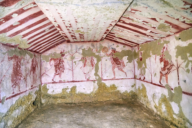 """Underground Etruscan tomb Known as """"Tomba Massimo Pallottino no 3713"""". A single chamber with double sloping ceiling decorated. On the back wall are a painted dancing harpist, and couples dancing holding dinking cups.  Circa 580 BC. Excavated 1962, Etruscan Necropolis of Monterozzi, Monte del Calvario, Tarquinia, Italy. A UNESCO World Heritage Site."""