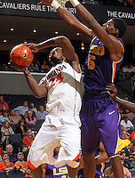 Jan. 2, 2011; Charlottesville, VA, USA; Virginia Cavaliers guard K.T. Harrell (24) is defended by LSU Tigers forward Malcolm White (5) during the game at the John Paul Jones Arena. Virginia won 64-50. Mandatory Credit: Andrew Shurtleff-