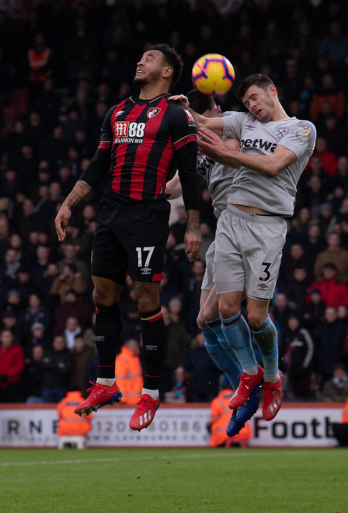 West Ham United's Aaron Cresswell (right) battles with Bournemouth's Joshua King (left) <br /> <br /> Photographer David Horton/CameraSport<br /> <br /> The Premier League - Bournemouth v West Ham United - Saturday 19 January 2019 - Vitality Stadium - Bournemouth<br /> <br /> World Copyright &copy; 2019 CameraSport. All rights reserved. 43 Linden Ave. Countesthorpe. Leicester. England. LE8 5PG - Tel: +44 (0) 116 277 4147 - admin@camerasport.com - www.camerasport.com