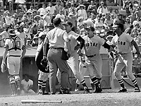 Boston Red Sox Eddie Kasko argues with home umpire over out call at home on Bob Burda, Tommy Harper on far right. (1972 photo/Ron Riesterer)