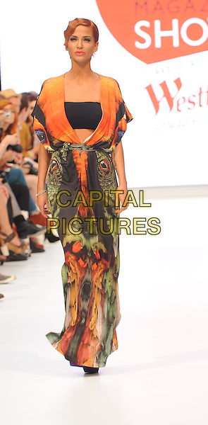 Sarah Harding.The Look Magazine Fashion show, Westfield, Stratford, London, England..September 18th, 2011.LFW full length runway orange green print catwalk runway maxi dress purple ankle boots black walking .CAP/WIZ.© Wizard/Capital Pictures.