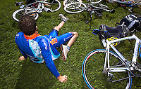24 APR 2011 - NICE, FRA - A competitor stretches before the start of the first round of the men's 2011 French Grand Prix triathlon series (PHOTO (C) NIGEL FARROW)