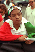 Cinco de Mayo spectator  age 15 draped in Mexican flag.  St Paul Minnesota USA