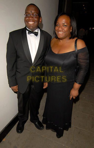 DIANE ABOTT & GUEST.Attends the London Black Leaders' Dinner at The Dorchester Hotel, London, England, August 28th 2007..full length black off the shoulder dress.CAP/SW.©Stephen Walters/Capital Pictures.