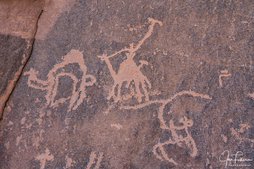 Ancient rock art depicting a camel caravan in Khaz'ali Canyon in the Wadi Rum Protected Area, a UNESCO World Heritage Site.  The petroglyphs are of Thamudic origin and are more than 2000 years old.