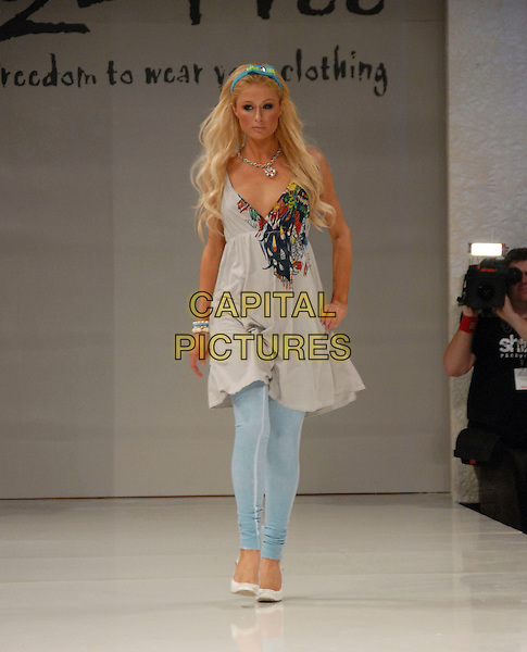 PARIS HILTON.At The 2 B Free Fashion Show held at Boulevard3  in Hollywood, LA, California, USA, March 19 2007..full length modelling runway grey dress blue leggings catwalk hand on hip hairband hair band white shoes.CAP/DVS.©Debbie VanStory/Capital Pictures