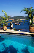 Buzios, Rio de Janeiro, Brazil. The Byblios Hotel pool with the sea and a private yacht beyond.