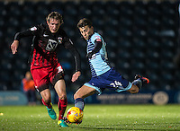 Scott Kashket of Wycombe Wanderers shoots under pressure from Callum Maycock of Coventry City during the The Checkatrade Trophy Southern Group D match between Wycombe Wanderers and Coventry City at Adams Park, High Wycombe, England on 9 November 2016. Photo by Andy Rowland.