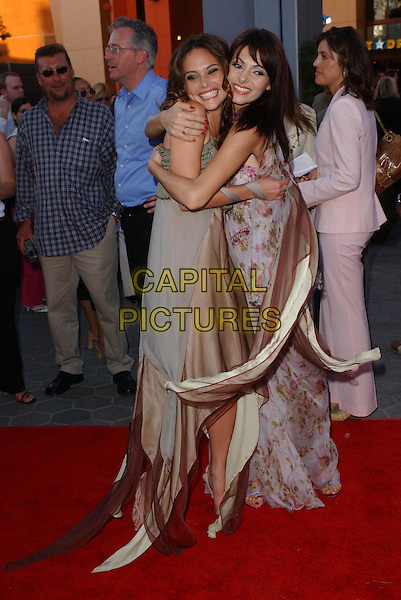 JOSIE MARAN & SILVIA COLLACA.Attending the world premiere of movie Van Helsing at The Universal City Walk in Universal City, California..May 3rd 2004.full length full-length hugging smilinglong floaty dress.*UK sales only*.www.capitalpictures.com.sales@capitalpictures.com.©Capital Pictures