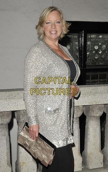 Deborah Meaden.attended the Inspiration Awards For Women, Cadogan Hall, Sloane Terrace, London, England, UK, October 7th 2011..half length silver cardigan black trousers  clutch bag side  sequined sequin .CAP/CAN.©Can Nguyen/Capital Pictures.